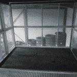 Magazijnlift met speciale vloer voor vervoer autobanden - De Jong's Liften